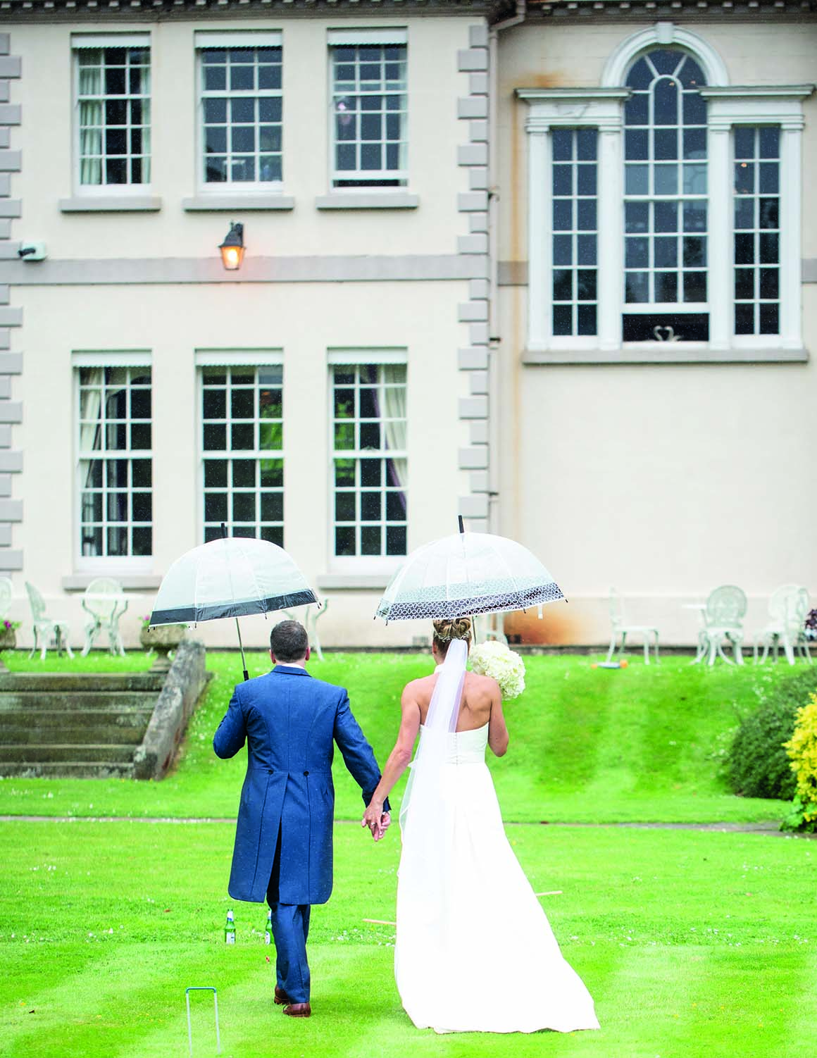 Brockencote Hall Hotel Wedding prices bride and groom with umbrella