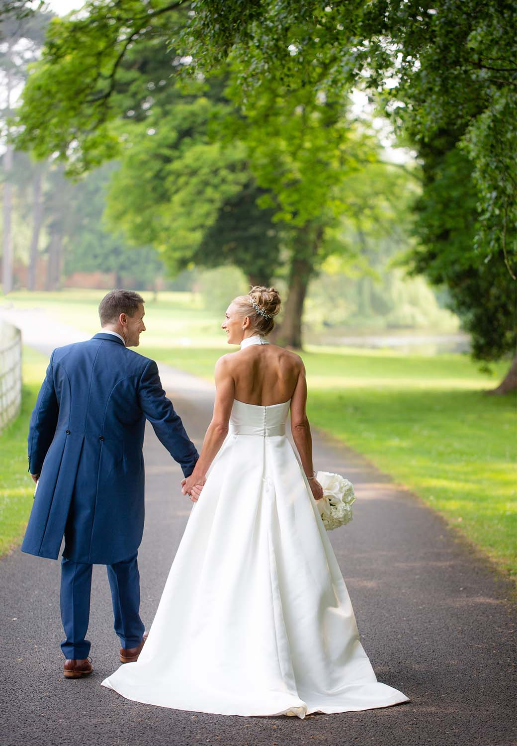Wedding venues Worcestershire couple walking down drive
